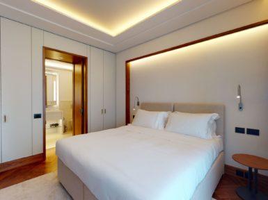 Bedroom with bathroom door